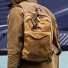 Filson Journeyman Backpack 11070307 Tan carrying on the shoulder