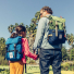 Topo Designs Rover Pack Classic Olive/Navy carrying men and child