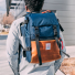 Topo Designs Rover Pack Heritage Navy/Brown Leather men carrying