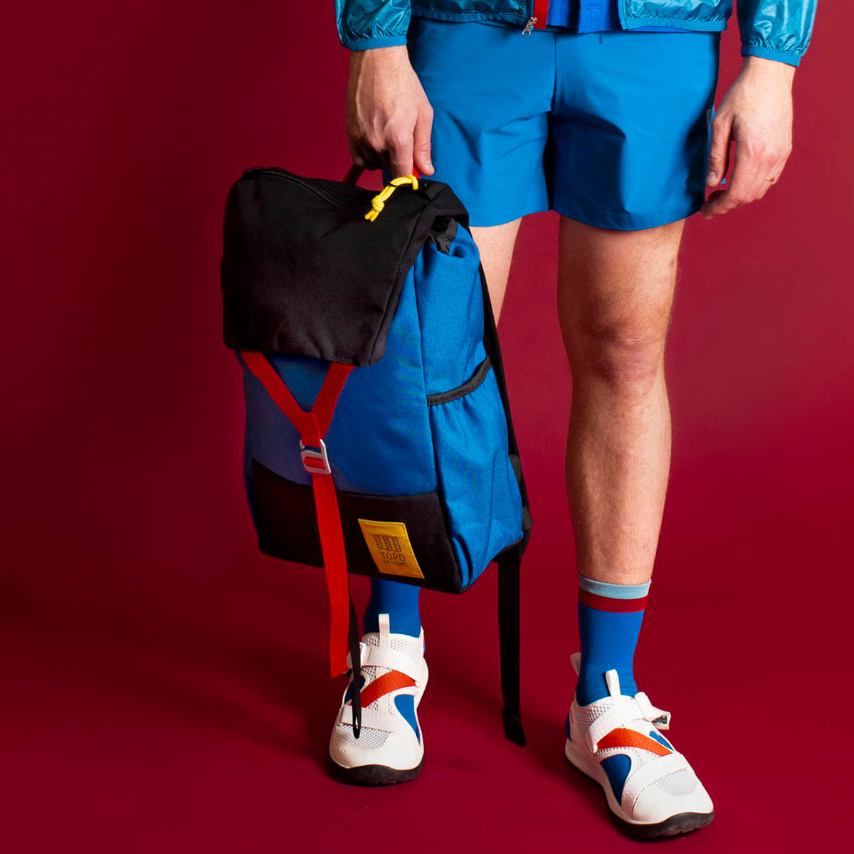 Topo Designs Y-Pack Blue/Black fuses classic style and modern functionality