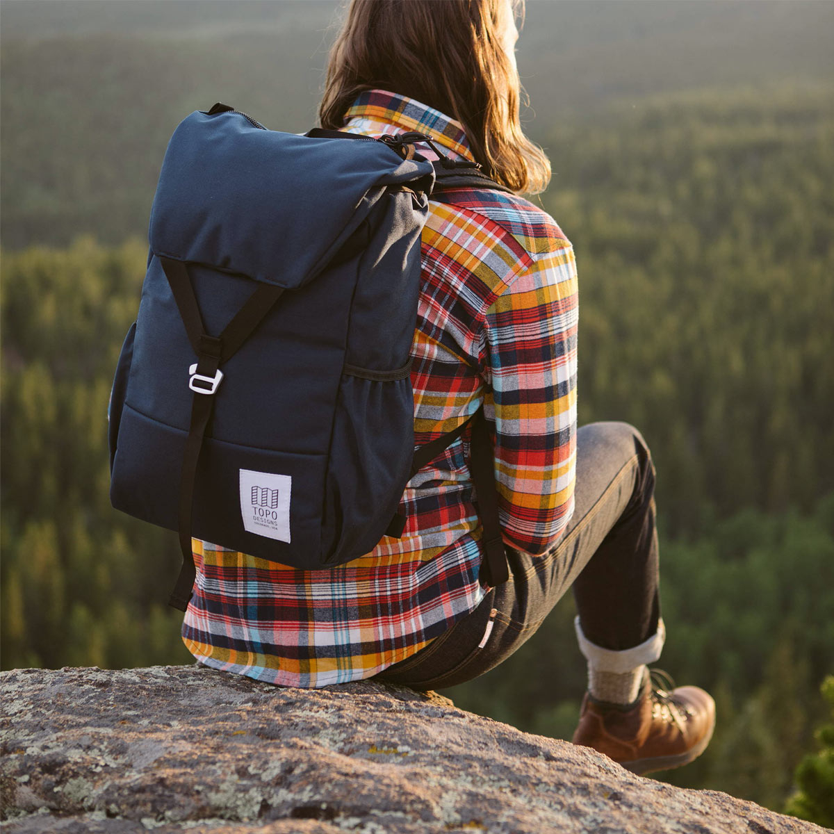 Topo Designs Y-Pack Navy fuses classic style and modern functionality