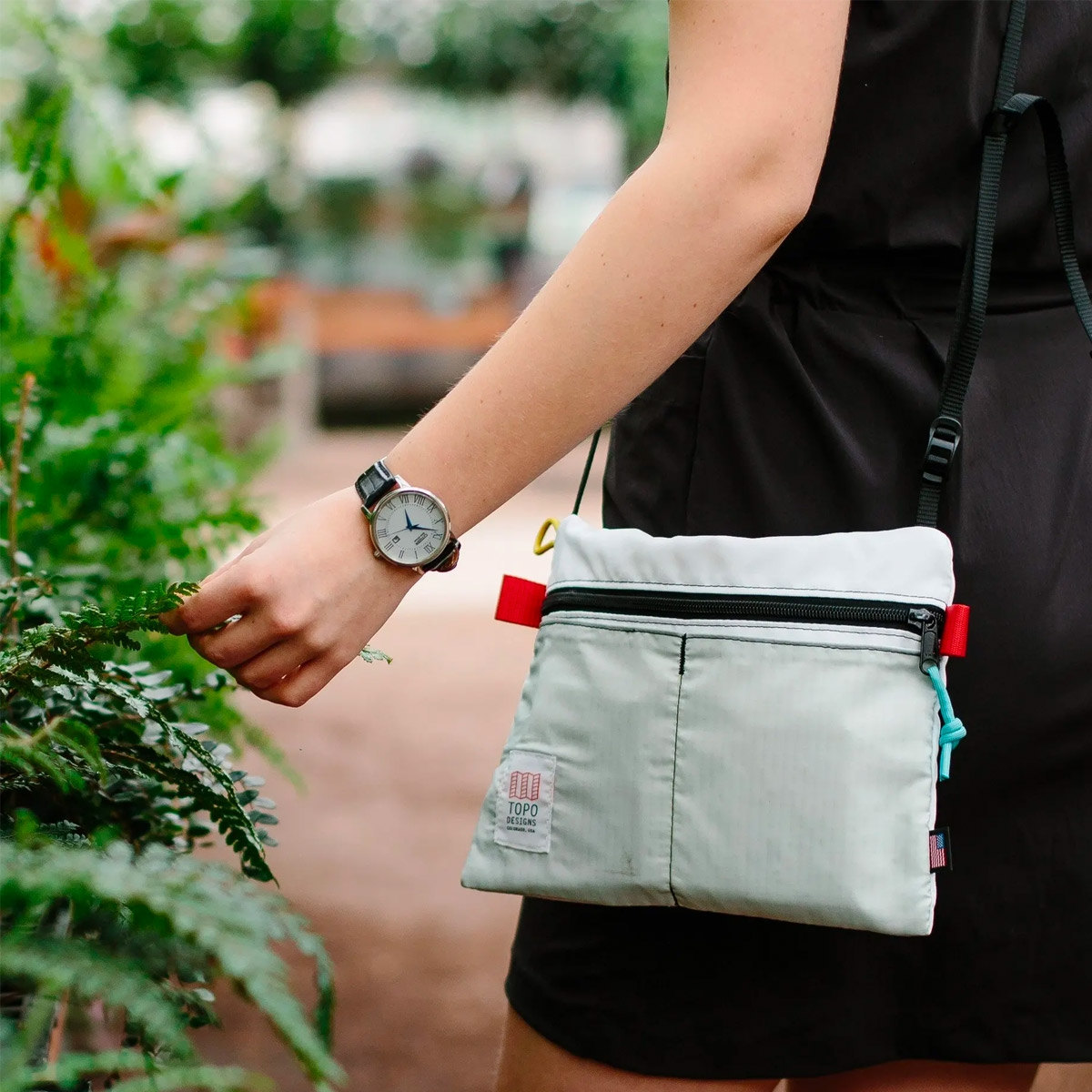 Topo Designs Accessory Shoulder Bag Black, small crossbody bag with external pockets for your phone or keys